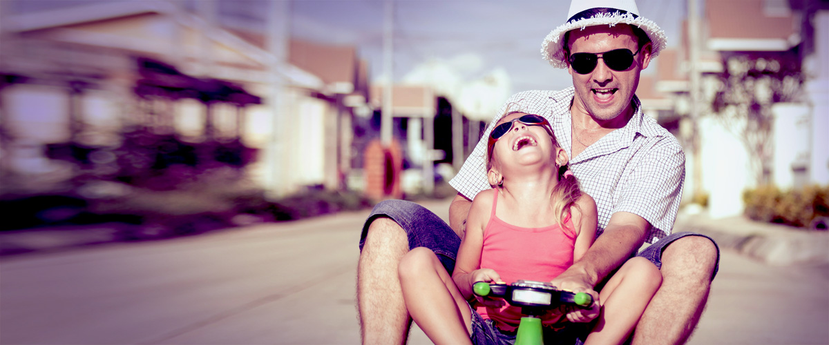 Father and daughter riding scooter, IPH Home Insurance